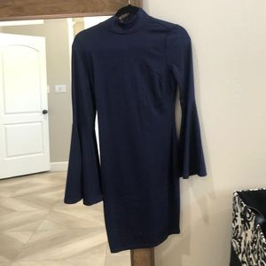 Form fitted high neck navy blue Venus dress.